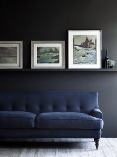 Moody blue and charcoal. Nice low picture rail too blending in with wall colour