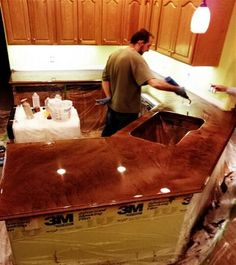 This is it! This is what I want... epoxy to cover existing countertops. In addition to this website Home Depot has kits in a variety of colors. Love the look, durability, and especially the price. Plus we won't end up ripping out our existing countertops just because the have a little wear and tear. Perfect, perfect, perfect option!