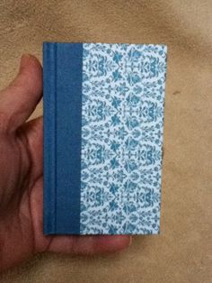 Blank pocket size book. Blue paper backed book cloth on spine and beautiful floral on covers. Made by Roxanne