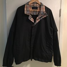 Burberry Golf Jacket size M Classic Burberry never goes out of style. Black men's jacket with removable sleeves and signature lining purchased at Neiman Marcus. Burberry Jackets & Coats
