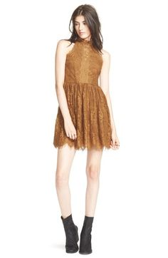 "Free shipping and returns on Free People 'Verushka' Minidress at Nordstrom.com. <p><B STYLE=""COLOR:#990000"">Pre-order this style today! Add to Shopping Bag to view approximate ship date. You'll be charged only when your item ships.</b></p><br>This elegant minidress fits the bill for any special occasion thanks to a full skirt, a cool halter neckline and plenty of eyelash lace."