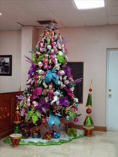 Candy Land inspired Christmas Tree... I did this for my old job, oh boy that was a huge tree!! It took around 4 hours to decorate (360°) a 12ft rotating tree