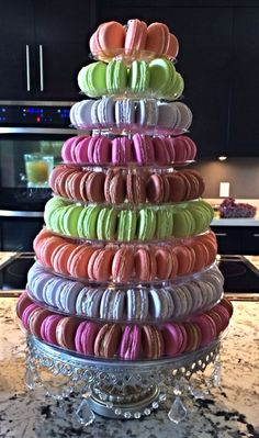 My first French Macaron Tower. Peach, Key Lime, Fruity Pebbles, Raspberry and Salted Caramel French Macarons.