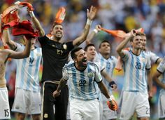 Argentina's Ezequiel Lavezzi and teammates celebrate at the end of the World Cup quarterfinal soccer match between Argentina and Belgium at the Estadio Nacional in Brasilia, Brazil, Saturday, July 5, 2014. Argentina won 1-0.