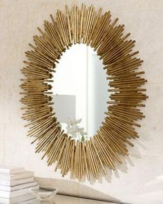 Arteriors Prescott Oval Iron Mirror: Wall mirror in starburst frame creates a stunning look over a sofa or hall console. Handcrafted of iron with gold leaf finish.