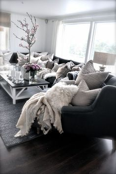 Villa Paprika - dark couch with loads of pillows.