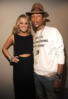 Carrie Underwood and Pharrell Williams backstage at the TIME 100 Gala in New York City.
