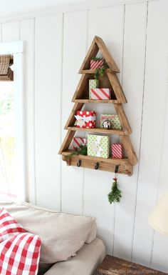 DIY Tree Shelf A DIY tutorial to build a tree shelf perfect for holiday decor. Free plans from Ana White make this an easy diy project for that special someone. Wood Christmas Tree, Christmas Tree Decorations, Christmas Fun, Xmas, Holiday Tree, Pottery Barn Christmas, Christmas Tree Storage, Christmas Signs, Rustic Christmas