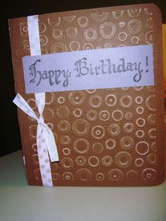 """This is a quick birthday card I made """"ta-da"""" without the Cricut!! In a pinch any card looks great with dry embossing, stamping and ribbon.   Supplies:    Core'dinations cardsatock, DCWV cardstock   Cuttlebug and Cuttlebug spots and dots embossing folder   diamon patterned ribbon from my stash   Happy Birthday stamp from Just for Fun http://www.jffstamps.com/products.asp?cat=12  Stazon ink - black"""