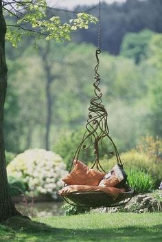 How exotic is this swing seat?!? Imagine two set together with a funky natural art table to complete the vignette. Now time to serve rasberry tea!