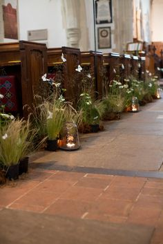 Wheat Grass + Butterflies + Candles in Jars = Pretty Wedding Aisle Decor! #weddingceremony #wedding #aisledecor