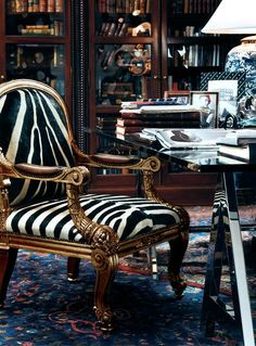 a refined vintage armchair with zebra print upholstery