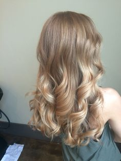 Blonde hair color warm highlights beige caramel honey buttery waves style curls