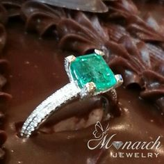 #Emerald and #diamond #ring placed on top of David's #chocolate birthday cake! #Monarch #Jewelry in #Winter #Park , #Florida
