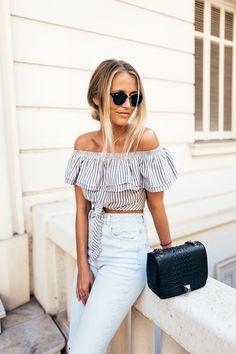 striped off the shoulder top with high waisted jeans - a classy and retro inspired spring outfit idea