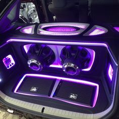 XThunder amplifiers recessed into a false floor and 75 series subwoofers in this custom trunk install.