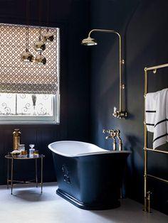Charcoal grey bathroom with free-standing bath; modern bathroom design at allaboutyou.com