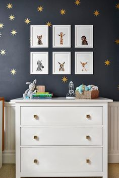 Gold square knobs accent a white dresser placed in front of a white beadboard trim and beneath The Animal Print Shop Baby Animal Prints hung from a black upper wall. Baby Dresser, Nursery Dresser, Gold Nursery, White Nursery, Dresser Knobs, Dresser As Nightstand, Nursery Room, Boy Room, Nursery Ideas