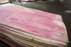 Pages of history have turned pink after water damage caused the red cover to bleed onto the book's pages. Information Governance, Records Management, Attorney General, The Book, Things To Come, Coding, Water Damage, History, Cover