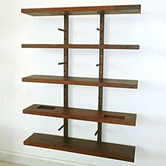Portland designer William Ullman uses solid reclaimed American Black Walnut to create these substantial and sculptural shelves based on a simple peg system.  The pegs are easily repositioned on the wall mounted blocks to allow shelf heights to be adjusted.  Five shelves are included, one of which features two routed niches that can be used for keys, mail, or to rest a mobile phone.  This is a versatile product that can be used in the home or in commercial spaces.  Hand-rubbed with an all ...