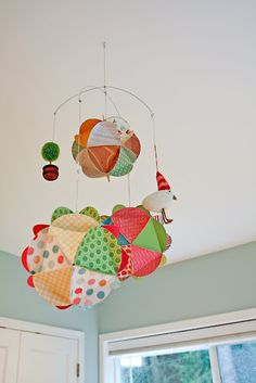 Gather together your favorite pictures and scrapbook paper and create a gorgeous paper globe mobile for your nursery!