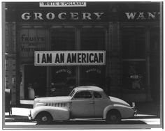 """""""I am an American"""" sign placed in the window of an Oakland, CA store, owned by the Masuda family, the day after Pearl Harbor. The store was closed in 1942, when the family was relocated to an internment camp."""