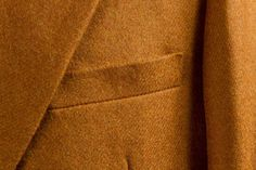 Vicuna cloth close up, slightly slanted breast pocket to enhance the masculine chest.