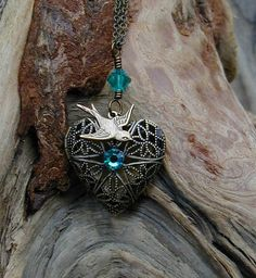 Hunger Games Necklace -A Love Locket with Teal Crystals. $14.99, via Etsy.
