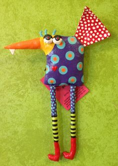 Made from up-cycled fabrics, sewn into fun critters, stuffed with plastic bags, primed for stiffness and hand-painted for vibrant color and personality! By Jodie Flowers