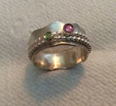 Sterling silver spinner ring with pink tourmaline and peridot by Caribbeanmemories on Etsy