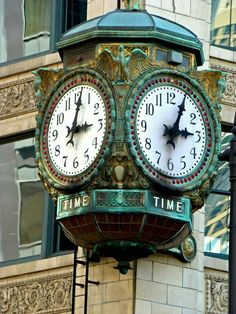 "Old Chicago Clock. This is an old ornate clock that's popular among ""All things Chicago."" It is on the corner of a building at E Wacker Place and N Wabash Avenue in downtown Chicago. It has four faces and the word 'Time' under the dials. Unusual Clocks, Outdoor Clock, Old Clocks, Vintage Clocks, Father Time, Somewhere In Time, As Time Goes By, Time Clock, Grandfather Clock"