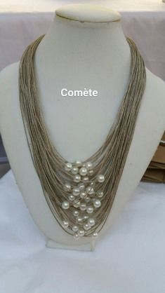 Items similar to This linen thread and pearly ivory beads necklace, is bird eye shape. on Etsy - This linen thread and pearly ivory beads necklace is image 0 - Diy Jewelry Rings, Bead Jewellery, Pearl Jewelry, Jewelry Crafts, Beaded Jewelry, Jewelery, Jewelry Making, Fabric Necklace, Fabric Jewelry