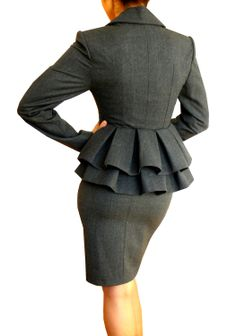 This jacket is great for the curvy woman. It accentuates the curves, sits right between the buttocks so she doesn't appear to tall or too short, and cinches at the waist to further show-off her hourglass (standard) shape. The ruffles at the back, give even more shape and dimension to the suit. This is a medium textured fabric, which would be great for a medium body frame.