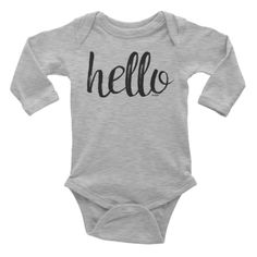 Hello Onesie #beanandjean Printed on American Apparel long-sleeve baby onesie  Soft, comfortable, and made of 100% cotton. It's designed to fit infants of all sizes, with a rib knit to give good stretch and a neckband for easy on-and-off.  • 100% baby rib cotton construction (heather contains 10% polyester) • Made and printed in the USA • Neckband for easy on-and-off • Not intended for sleepwear • Shrinkage: it will shrink an average of one size when put in the dryer