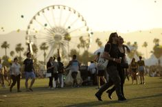Attendees of the 2014 Coachella Music Festival walk through the Empire Polo Field on the third day of the festival in Indio, California, on April 13, 2014. (Chris Pizzello/Invision/AP)