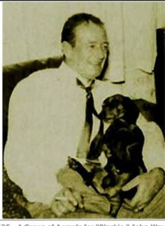 John Wayne dachshund Blakie - enjoyed brief fame of his own when he awoke Mrs. Wayne when there was a fire in their home. Allowing her and their 20 month old daughter to escape fire
