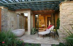 Outdoor bathtub and shower adjacent to the bathroom indoors - Decoist
