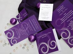 Silver and royal purple themed wedding stationery with spiral design