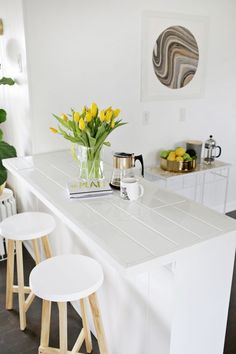 We tend to think of tiled countertops as a cheap and imperfect solution, when marble or quartz just isn't in your remodeling budget. Instead of approaching the update with mixed feelings, look to these surfaces as reassurance that your kitchen or bath will still fresh and clean — they just won't break the bank.