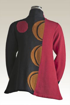 Sandra Miller  Love the use of color and design on this jacket. The swing at the bottom gives it a fluidity that enhances the design.