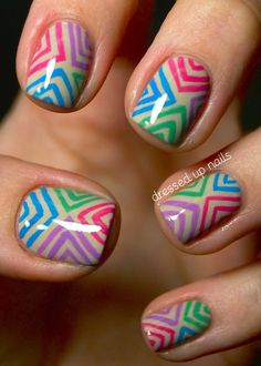 Difficulty level: 3. First, apply base coat and let dry. Next, apply two coats of a tan or cream polish. Then, pick four nail pens. After, make three different sized triangles on the top edge of your nails towards the center of the nail. Do the same on all other sides of your nails. Finally, apply top coat.