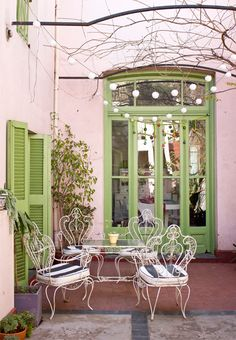 extreme patio envy wrought iron chairs that green from the seventies // via casa chaucha