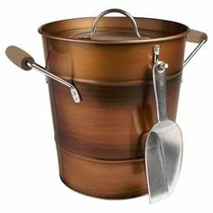 """Serve a scotch on the rocks or chill a bottle of bubbly with this handsome ice bucket, showcasing an antique copper finish.   Product: Ice bucket, lid, and scoopConstruction Material: MetalColor: Antique copperDimensions: 9"""" H x 10"""" Diameter"""