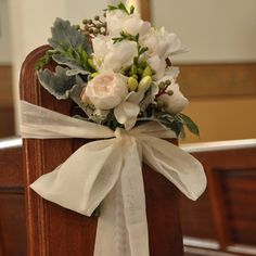 church pew bow and floral arrangement
