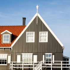 Marken by Wouter and Canon, via Flickr | #warm #cool #orange #brown #blue #architecture #sky