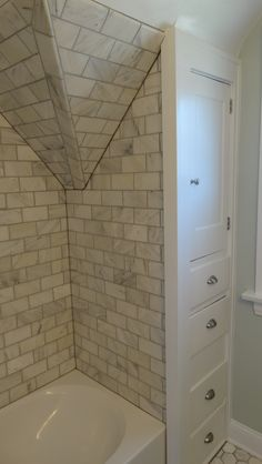 Bathroom remodel with Tile shower/tub combo and built ins