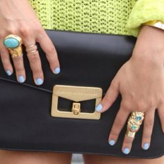 Nails, purse, and rings.... I like it all