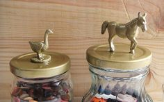 saw these on Pinterest + i have many mason jars + some leftover rubber animals + the need to cover ugly jar lids let's get started! you'll need some rubber animal toys + cleaned mason jars + max bond...