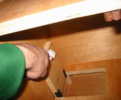 Cheap secret compartment!  This will show you how to make a secret compartment that can be built into a bookcase, or some other piece of furniture. It uses a sneaky lock that doesn't expose any hardware to the surface.