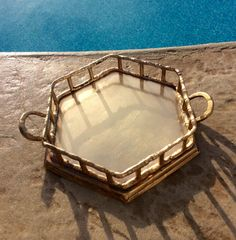 This is a solid brass, small bamboo tray. Hexagon shape with handles. Great for vanity, barcart decor, coffee table or bookshelf decor! Versatile small tray! In very good polished condition! I have small round brass bamboo tray also in shop, sold separately!  Measures 7 handle to handle, 5.5 diameter X 1.25 height Thanks for shopping YellowHouseDecor!  Please visit my sisters shop for more vintage items ( ellansrelics02)